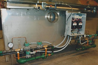 Large gas-heated black oxide tank with electronic ignition system.
