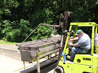 Our employees carefully loading Easy Black System onto wooden skids prior to shipment.