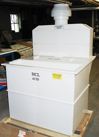 Front view of Polypropylene Hydrochloric Acid Tank with attached front rinse tank, hood, and exhaust blower.